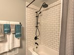 Take a refreshing rinse in the sleek shower/tub combo!