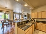 The kitchen is fully equipped, complete with stainless steel appliances.