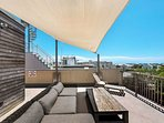 Roof Top Seating With Sail Overhead for Shade