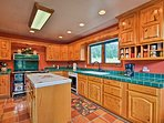 Evergreen tiles and hardwood cabinets bring the mountains into the cabin.