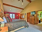 Sweeping mountain views frame the queen bed for an unforgettable experience.