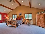 The spacious master bedroom has vaulted ceilings with exposed beams.