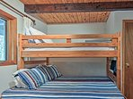 The bunk room has a twin-over-full bunk bed with a twin trundle bed.