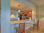 Pull up a seat to the 4-person breakfast bar.