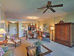 High-end tropical decor and hardwood furnishings detail the living space.