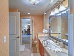 Spacious countertops and bright lighting complete the bathroom.