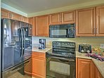 Spacious wooden cabinets and extended counters make cooking a treat.