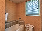 Take a soothing soak in the adjacent tub before crawling into bed.