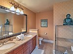 Double sinks and an extended counter turn this bathroom into a spacious oasis.