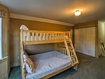 The upstairs room has ample closet space and a twin-over-full bunk bed.