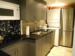 Full Kitchen with Stainless Steel Refrigerator, Pots, Pans, Utensils and Dishes