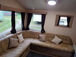 Main seating area converts to double pull out sofa bed