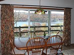 Dining room table with sliding glass doors to access front porch.