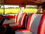 Take your seat; our stunning 1972 VW Camper Miss Scarlett is waiting to take you on an adventure.