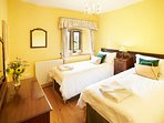 The Norfolk Room with beds that can be arranged as a king size bed or two single beds