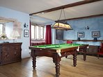 The Billiards Room on the ground floor of Blencowe Hall with an antique table