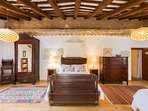 Penedes bedroom - double and two single beds with ensuite bathroom