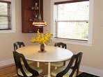 Lucite Tulip chairs and a 70s dining table add to the retro chic of the cottage styling