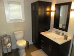 Nicely renovated bathroom with shower, toilet and sink. There is plenty of storage in the vanity.