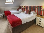 Newly refurbished twin bedroom in Old Stables