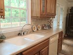 Wonderful double porcelain sink w window to view deck & enormous back yard.