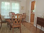 Dining room w Early American antique table-yes, please use it! Seats 8. China for special events too