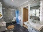 Ground floor spacious en suite wet room , ideal for guests with restricted mobility.