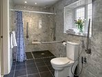 Ground floor, newly refurbished, spacious en suite wet room in Woodpecker, grab rails & seating.