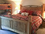 This room sleeps 5 on a king bed, twin-over-twin bunk bed and a twin trundle.