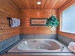Draw a hot bubble bath in the jacuzzi bathtub.