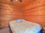 The second bedroom features a cozy full bed.