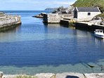 Ballintoy Harbour, featured in Game of Thrones is 7 miles away.