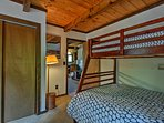 This bedroom includes a twin-over-full bunk bed and twin trundle bed.