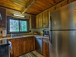The updated, fully equipped kitchen boasts stainless steel appliances.