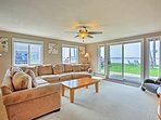 Curl up on the living room couch as sunshine pours through the large windows.