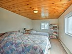 Sleep soundly upon the queen bed and full bed in the fourth bedroom.