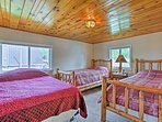 The third bedroom features 2 twin beds and a full bed.