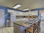 Prepare meals in the fully equipped kitchen.