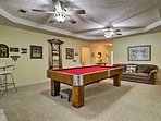 Make your way to the game room to play billiards.