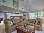 Relax in the open floor plan, combining the living room, kitchen & dining area.