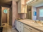 Get ready for the day in the master en-suite bathroom.