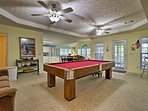 This room offers a regulation pool table for entertainment.