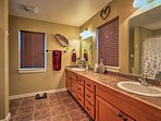 A double-sink vanity highlights this spacious bathroom.