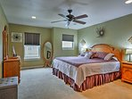 The master bedroom boasts a luxurious king-sized bed.