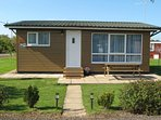 Cedar Lodge, sleeps 4 in 2 bedrooms.  Awarded 3 Star Gold rating by Visit England.
