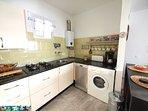 kitchen with washing machine, dishwasher etc.