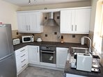 Fully fitted kitchen with fridge/freezer, cooker/hob, kettle, toaster, microwave and coffee machine.