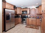 A fully-stocked gourmet kitchen with stainless appliances makes it easy to cook meals!