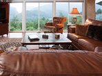 The family room features large windows, a mountain view, big screen TV and spacious seating!