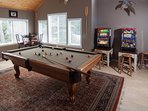 The game rooms features a pool table, foosball, ping pong, children's toys and slot machines!